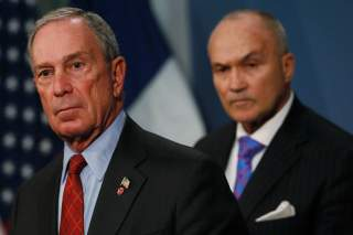 New York City Mayor Michael Bloomberg and New York Police Department (NYPD) Commissioner Ray Kelly (R) attend a news conference about a judge's ruling on