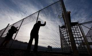 A view of gates to an exercise yard for inmates at Kingston Penitentiary in Kingston, Ontario October 11, 2013. REUTERS/Fred Thornhill