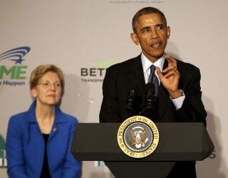 U.S. President Barack Obama delivers remarks at AARP headquarters in Washington February 23, 2015. Senator Elizabeth Warren (D-MA) listens at left. REUTERS/Gary Cameron