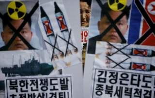 A woman from an anti-North Korea and conservative civic group attends a rally marking the fifth anniversary of the sinking naval ship Cheonan in central Seoul March 26, 2015.