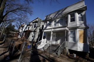A row of empty abandoned homes is seen in East Orange, New Jersey, March 25, 2015. REUTERS/Mike Segar