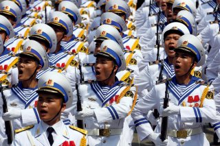 Vietnamese honour guards in Navy uniform march during a welcoming ceremony to Philippines President Rodrigo Duterte at the Presidential Palace in Hanoi, Vietnam September 29, 2016. REUTERS/Kham