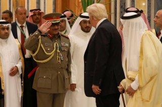 A military officer salutes U.S. President Donald Trump (2-R) and Saudi Arabia's King Salman bin Abdulaziz Al Saud (R) as they attend the Arab Islamic American Summit in Riyadh, Saudi Arabia May 21, 2017. REUTERS/Jonathan Ernst