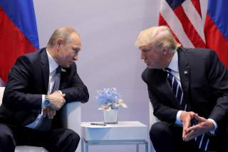 Russia's President Vladimir Putin talks to U.S. President Donald Trump during their bilateral meeting at the G20 summit in Hamburg, Germany, July 7, 2017. REUTERS/Carlos Barria