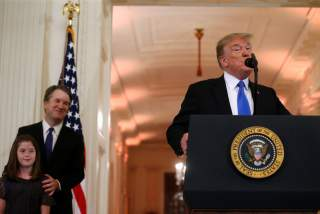 U.S. President Donald Trump introduces Supreme Court nominee judge Brett Kavanaugh (L) in the East Room of the White House in Washington, U.S., July 9, 2018. REUTERS/Leah Millis
