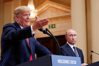 U.S. President Donald Trump gestures during a joint news conference with Russia's President Vladimir Putin after their meeting in Helsinki, Finland, July 16, 2018. REUTERS/Kevin Lamarque