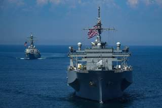 The U.S. Navy Arleigh Burke-class guided-missile destroyer USS Porter and the Blue Ridge-class command and control ship USS Mount Whitney sail in formation during the U.S.-Ukraine multinational maritime exercise Sea Breeze 2018 in the Black Sea July 13, 2