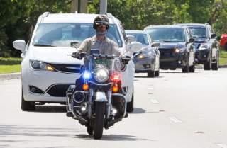 Miami-Dade police motorcycle officers escort a motorcade to FBI headquarters in Miramar, Florida, U.S. October 26, 2018. REUTERS/Joe Skipper