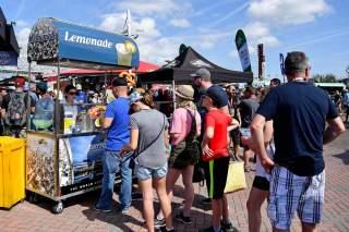 Feb 17, 2019; Daytona Beach, FL, USA; Fans line up at a lemonade stand prior to the Daytona 500 at Daytona International Speedway. Mandatory Credit: Jasen Vinlove-USA TODAY Sports