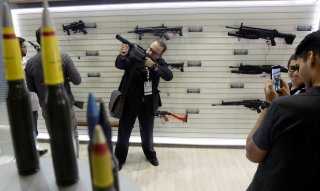 A man holds a gun during LAAD, the biggest military industry expo in Latin America in Rio de Janeiro, Brazil April 2, 2019. REUTERS/Ricardo Moraes