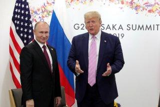 Russia's President Vladimir Putin and U.S. President Donald Trump attend a meeting on the sidelines of the G20 summit in Osaka, Japan June 28, 2019. Sputnik/Mikhail Klimentyev/Kremlin via REUTERS