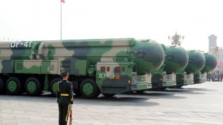 Military vehicles carrying DF-41 intercontinental ballistic missiles travel past Tiananmen Square during the military parade marking the 70th founding anniversary of People's Republic of China, on its National Day in Beijing, China October 1, 2019. REUTER