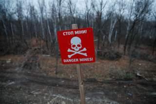 A landmine warning sign is seen near the contact line between Ukrainian troops and pro-Moscow rebels in the settlement of Stanytsia Luhanska, Ukraine November 20, 2019. REUTERS/Gleb Garanich