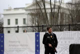 FILE PHOTO: A Secret Service agent stands guard outside the White House in Washington, U.S., January 3, 2020. REUTERS/Leah Millis/File Photo