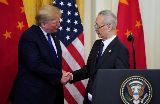 U.S. President Donald Trump shakes hands with Chinese Vice Premier Liu He during a signing ceremony for