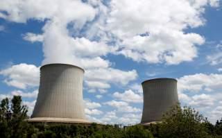 FILE PHOTO: Cooling towers of Electricite de France (EDF) nuclear plant are seen in Saint-Laurent-Des-Eaux near Orleans, France, June 17, 2019. REUTERS/ Regis Duvignau/File Photo