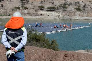 FILE PHOTO: Solar panels are seen during the inauguration of the world's first-ever 'island' of solar panels in a tailings pond of Anglo American's Los Bronces copper mine, on the outskirts of Santiago, Chile March 14, 2019. REUTERS/Rodrigo Garrido