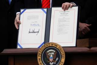 U.S. President Donald Trump shows off the United States-Mexico-Canada Trade Agreement (USMCA) after signing it on the South Lawn of the White House in Washington, U.S., January 29, 2020. REUTERS/Leah Millis