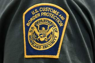 FILE PHOTO: A U.S. Customs and Border Protection patch is seen on the arm of a U.S. Border Patrol agent in Mission, Texas, U.S., July 1, 2019. REUTERS/Loren Elliott/File Photo