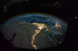 A NASA satellite image, taken by one of the Expedition 25 crew members on the International Space Station, shows the lights of Cairo, Alexandria and the Nile River, Egypt October 28, 2010. Picture taken October 28, 2010. NASA/Handout via REUTERS