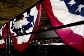 A bunting banner hangs over a railing for Democratic presidential candidate former South Bend, Indiana mayor Pete Buttigieg at his Caucus night rally in Des Moines, Iowa, U.S., February 3, 2020. REUTERS/Eric Thayer