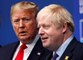 FILE PHOTO: Britain's Prime Minister Boris Johnson welcomes U.S. President Donald Trump at the NATO leaders summit in Watford, Britain December 4, 2019. REUTERS/Peter Nicholls/File Photo