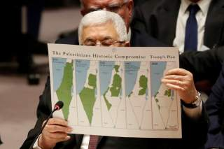 Palestinian President Mahmoud Abbas holds a document while speaking during a Security Council meeting at the United Nations in New York, U.S., February 11, 2020. REUTERS/Shannon Stapleton