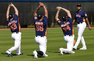 West Palm Beach, Florida, USA; Houston Astros pitcher Lance McCullers Jr (43) and pitcher Bryan Abreu (66) and pitcher Kent Emanuel (64) and pitcher Josh James (right) stretch during a spring training workout at FITTEAM Ballpark. Feb 14, 2020;Rhona Wise-