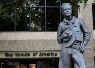 FILE PHOTO: The statue of a scout stands in the entrance to the Boy Scouts of America headquarters in Irving, Texas, February 5, 2013. REUTERS/Tim Sharp/File Photo