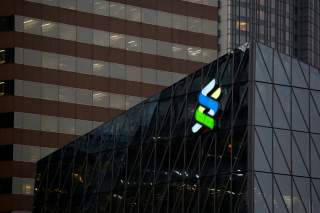 FILE PHOTO: A logo of Standard Chartered is displayed at the financial Central district in Hong Kong, China November 23, 2017. REUTERS/Bobby Yip/File Photo GLOBAL BUSINESS WEEK AHEAD