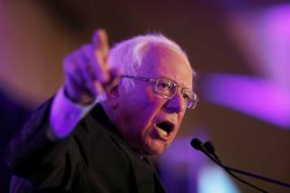 Democratic U.S. presidential candidate Senetor Bernie Sanders speaks with voters at the First in the South Dinner in Charleston, South Carolina, U.S., February 24, 2020. REUTERS/Randall Hill