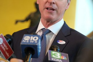 California's Governor Gavin Newsom wears an ?I Voted? sticker as he speaks to the media after casting his ballot at a voting center at The California Museum, during the presidential primaries on Super Tuesday in Sacramento, CA U.S., March 3, 2020. REUTERS