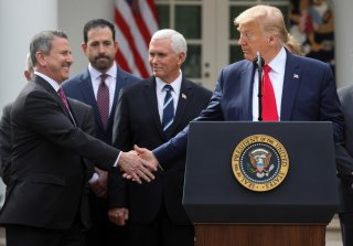 Brian Cornell, the Chairman and CEO of Target Corporation, reaches out and shakes hands with U.S. President Donald Trump after the president declared the coronavirus pandemic a national emergency during a news conference in the Rose Garden of the White Ho