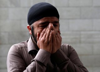 An Afghan Sikh cries inside a Sikh religious complex after an attack in Kabul, Afghanistan March 25, 2020.REUTERS/Mohammad Ismail