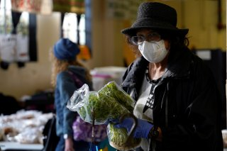 Dee Freeland buys fresh herbs at the Farmers Public Market in Oklahoma City, Oklahoma, U.S., March 21, 2020. Picture taken March 21, 2020. REUTERS/Nick Oxford