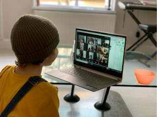 A school kid socializes with peers online following school closures due the spread of the coronavirus disease (COVID-19) outbreak, in London, Britain, March 20, 2020 in this picture obtained from social media on March 25, 2020. Anais Aguerre/via REUTERS
