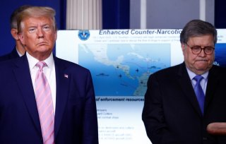U.S. President Donald Trump and U.S. Attorney General Bill Barr listen as the Trump administration and military leaders announce naval moves against Venezuela and narcotics traficking during the daily coronavirus response briefing at the White House