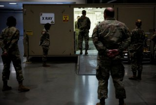 Army Chief of Staff General James McConville inspects the radiology unit at a military field hospital for non-coronavirus patients inside CenturyLink Field Event Center during the coronavirus disease (COVID-19) outbreak in Seattle, Washington, U.S., April