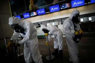 Members of the armed forces disinfect at Brasilia International Airport, amid the coronavirus disease (COVID-19) outbreak, in Brasilia, Brazil April 14, 2020. REUTERS/Ueslei Marcelino