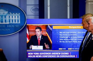 U.S. President Donald Trump and U.S. Vice President Mike Pence watch a video of New York governor Andrew Cuomo speaking at Cuomo's daily briefing, during the daily coronavirus disease (COVID-19) task force briefing at the White House in Washington, U.S.,