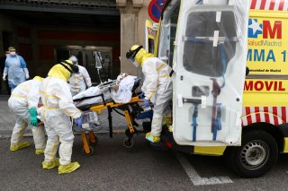 Members of Madrid's Emergency Service (SUMMA) wearing protective equipment transfer a patient suffering from coronavirus disease (COVID-19) to another hospital amid the coronavirus disease outbreak in Madrid, Spain, April 20, 2020. REUTERS/Sergio Perez