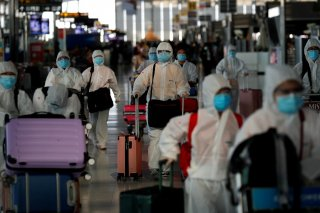 Chinese students living in Thailand wear protective suits as a measure of protection against thecoronavirusdisease (COVID-19) as they walk at the SuvarnabhumiAirportbefore boarding a repatriation flight, in Bangkok, Thailand April 21, 2020. REUTERS/Jo
