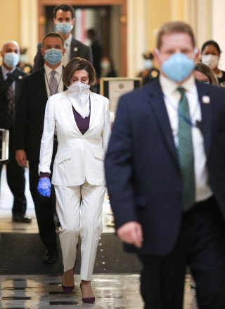 U.S. Speaker of the House Nancy Pelosi (D-CA) wears a face mask as she walks to the House Chamber ahead of a vote on an additional economic stimulus package passed earlier in the week by the U.S. Senate, on Capitol Hill in Washington, U.S., April 23, 2020