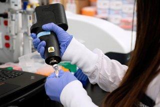 A scientist at RNA medicines company Arcturus Therapeutics research a vaccine for the novel coronavirus (COVID-19) at a laboratory in San Diego, California, U.S., March 17, 2020. REUTERS/Bing Guan