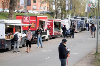People buy food from food trucks amid the outbreak of the coronavirus disease (COVID-19), in Stockholm, Sweden April 26, 2020. Jessica Gow/TT News Agency/via REUTERS