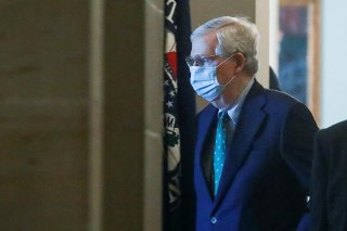 U.S. Senate Majority Leader Mitch McConnell (R-KY) wears a protective mask as he arrives at his office inside the U.S. Capitol after senators returned to Capitol Hill amid concerns that their legislative sessions could put lawmakers and staff at risk of c