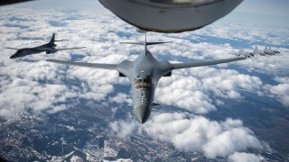 U.S. Air Force B-1B Lancer bomber aircraft from Ellsworth Air Force Base, South Dakota, fly in formation with Swedish Armed Forces Gripen fighter aircraft during a mission over Sweden, May 20, 2020. Picture taken May 20, 2020. U.S. Air Force/Tech. Sgt. Em
