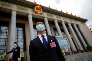 Security personnel wearing face masks following the coronavirus disease (COVID-19) outbreak stand guard outside the Great Hall of the People before the second plenary session of the National People's Congress (NPC) in Beijing, China May 25, 2020. REUTERS/