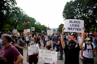 Demonstrators gather as they hold placards during a protest against the death in Minneapolis police custody of George Floyd, near the White House, in Washington, U.S., June 5, 2020. REUTERS/Eric Thayer