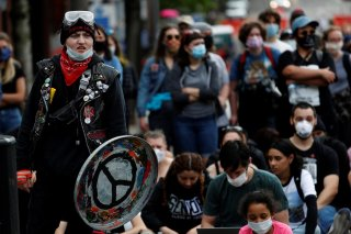 A man holds an improvised shield during a protest against racial inequality and call for defunding of Seattle police, in Seattle, Washington, U.S. June 10, 2020. REUTERS/Goran Tomasevic